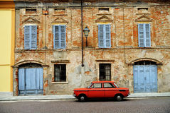 Red car on Italian street Royalty Free Stock Image
