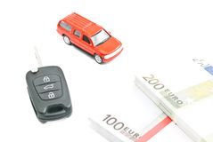 Red car with keys and money on white Stock Photography