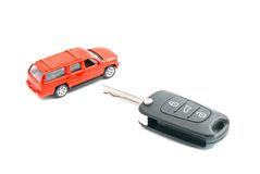Red car and keys on white Royalty Free Stock Image