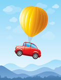Red car lifted by balloon Royalty Free Stock Photo