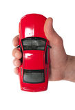 Red car in a man's hand Royalty Free Stock Photos
