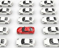 Red car among many rows of white cars Royalty Free Stock Photography