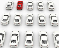 Red car among many white cars - top row Stock Image