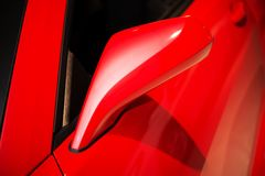 Red Car Mirror. Driving Theme. Transportation Concept Royalty Free Stock Photo