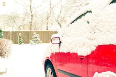 Red car and mirror snow capped. Winter-time outside. Outdoors. Red car and mirror snow capped. Winter-time outside. Outdoors horizontal image Stock Images