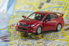 Red car modelon the background of a paper map of the city stock photo