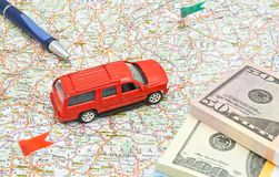 Red car, money and pen on map Royalty Free Stock Images