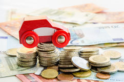 Red car and money Royalty Free Stock Photo