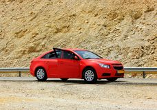 Red car on a mountain road Stock Images