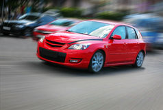 Red car in movement Royalty Free Stock Photography