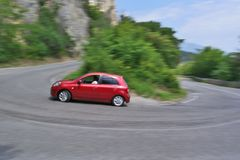 Red car is moving with drift. Car moving on road with drift royalty free stock image