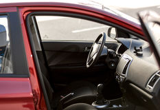 Red car with open passenger seat door Royalty Free Stock Photography