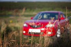 Red car. The red car outdoors, not in focus Royalty Free Stock Image
