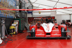 Red car in the pit. CHAMROUSSE, FRANCE, August 21, 2016 : A racing car at the pits. Chamrousse uphill racing cars competition takes place every year during Stock Photo