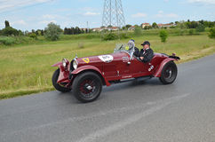 Red car racing the mille miglia race Stock Photography