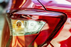 Red car rear light. Progressive aggressive design. There is an optical focusing lens Stock Images