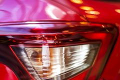 Red car rear light. Progressive aggressive design. There is an optical focusing lens Royalty Free Stock Photos
