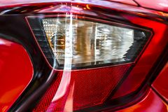 Red car rear light. Progressive aggressive design. There is an optical focusing lens Royalty Free Stock Image