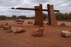 Red Car on Red Centre Way in Outback Australia Royalty Free Stock Photo