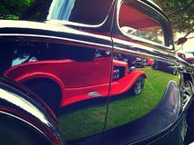 Red car reflected. In black car Royalty Free Stock Photo