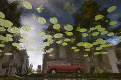 Red car reflection in canal. In delft, netherlands Royalty Free Stock Image