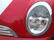 Red car reflector. Reflector of a shiny red car Stock Photo