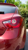 Red car right. Close up of a red passenger side car royalty free stock image