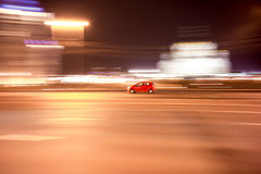 Red car on the road at night Royalty Free Stock Image