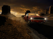 Red car running in the desert. A 1967 metal red ford mustang  in Monument Valley, driven by a blonde women, under the dawn Stock Photos