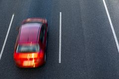 Free Red Car Runs Fast In The Highway By The Left Lane At Sunset. Top View And Copy Space In The Right Side. Royalty Free Stock Image - 120274196