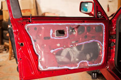 Red car sealant on the door Royalty Free Stock Photo