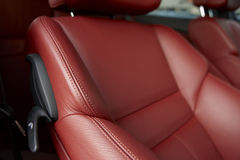Red car seats. Detail of a luxury car interior Stock Image