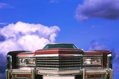 Red Car in Sky. Transport, Old-time Red Car on Background Sky with Cloud Stock Photo