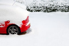 Red car in the snow Royalty Free Stock Images