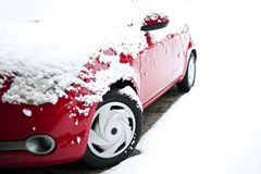 Red car in the snow Royalty Free Stock Image