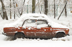 Red car in snowfall Royalty Free Stock Photography