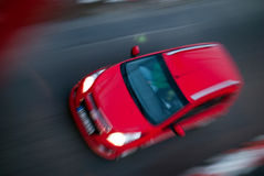 Red car. A speeding red car pushing the limits Royalty Free Stock Photo
