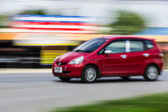 Red car Speeding in road Royalty Free Stock Photos