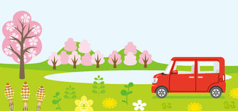 Red Car in spring nature Stock Photo