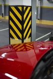 Red car is standing in the garage parking. This photo about Red car is standing in the garage parking stock photo