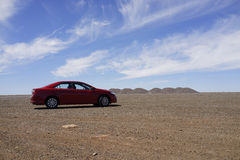 Red Car on Stuart Highway in Outback Australia Stock Photos