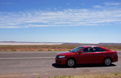 Red Car on Stuart Highway in Outback Australia Stock Photo