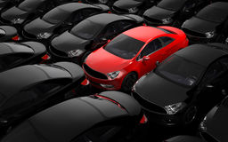 Red car surrounded by black cars Royalty Free Stock Images