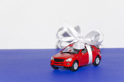 Red car, tied with white ribbon Royalty Free Stock Photos