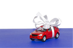Red car, tied with white ribbon Stock Photos