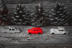 Red car toys and pine nuts on the wooden table Royalty Free Stock Photography