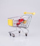 Red car in trolley. Red car in a supermarket trolley Royalty Free Stock Photography