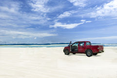 Car on a tropical beach Royalty Free Stock Photo