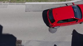 Red Car. VIENNA, AUSTRIA – APRIL 30th 2016: Birds eye view of a red car driving buy stock video footage