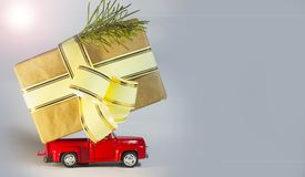 Red car, on white background, Christmas tree, gift box with ribbon Royalty Free Stock Images